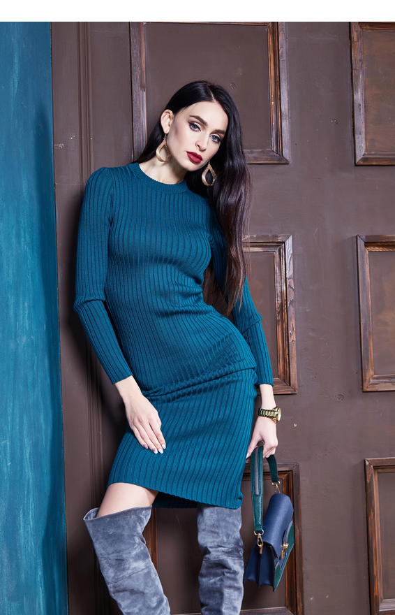 Beautiful sexy young woman brunette hair luxury chic wear casual style for date wool sweater blue color skinny dress pretty face autumn collection glamor model fashion clothes interior room brand bag.